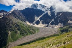 Glacier among the mountains of the North Caucasus. Royalty Free Stock Images
