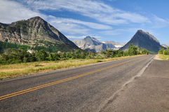 Glacier National Park. Long straight road with mountain view in Glacier National Park Stock Photography