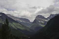 Glacier National Park Montana mountains. With cloudy skies above Royalty Free Stock Photo