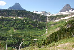 Glacier National Park Mountains. Snow melt waterfalls and mountains in Glacier National Park Stock Photo
