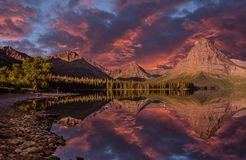 Glacier National Park, Upper Two Medicine Lake, Montana. Early morning reflection off of Two Medicine Lake, Montana. I had to get up at the crack of seven to get stock photography