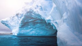 Glacier with natural cave inside swaying on water stock footage