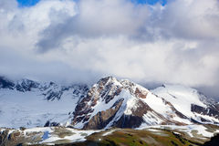 Glacier over the hill. A canadian Rocky Mountains glacier overlook some green hills Royalty Free Stock Photos