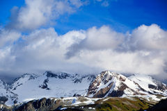 Glacier over the hill. A canadian Rocky Mountains glacier overlook some green hills Stock Photo