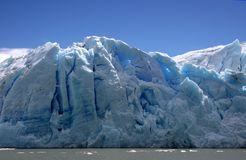 Glacier in Patagonia. Monumental glacier, with beautiful blue color, stands in front of the boat during tour in Chilean Patagonia Stock Image