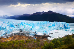 Glacier Perito Moreno and mountains. View of glacier Perito Moreno Glaciar Perito Moreno and slopes of Andes mountains, southeast of Argentina, province Santa royalty free stock photography