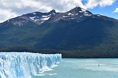 Glacier Perito Moreno and the Lago Argentino. The glacier Perito Moreno south of Argentina, in the Patagonia. A View that also contains mountains and the lake royalty free stock photography