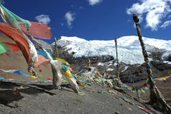 Glacier and prayer flags in Tibet Royalty Free Stock Photo