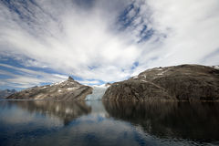 Glacier in Prins William Sound, Greenland. Cruising past glaciers & mountains with beautiful reflective waters in Prins William Sound, Greenland stock photo