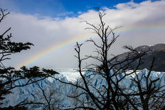 Glacier and rainbow over it. Royalty Free Stock Images