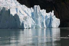 Glacier reflected on water. Glacier in Los Glaciares National Park, Calafate, Patagonia, Argentina Stock Photos