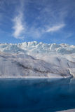 Glacier Reflection. View of blue water and blue sky on a glacier Royalty Free Stock Photo