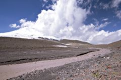 Glacier river against the Elbrus (5642m) in clouds Royalty Free Stock Image