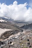 Glacier river against the Elbrus (5642m) in clouds Royalty Free Stock Photos