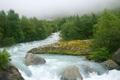 Glacier river in fog Stock Photo