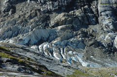 Glacier in rocky valley nearby Grindelwald in Alps. stock photography