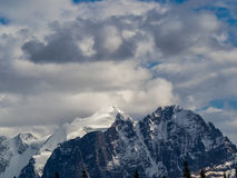 Glacier and snow capped mountain peaks Royalty Free Stock Photos