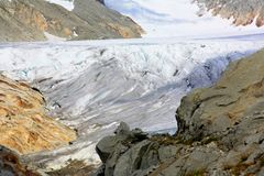 Glacier with Snow capped mountains Stock Photos
