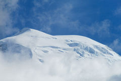 Glacier on the snow summit Royalty Free Stock Image