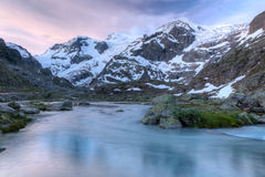 Glacier stream at sunset Switzerland Royalty Free Stock Photography