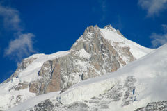 Glacier and summit in Chamonix valley, Alps. Glacier ice and snow falling in the Chamonix valley, Alps royalty free stock photos