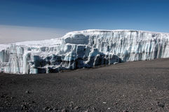 Glacier at the summit of mount Kilimanjaro. Ice spikes Iceberg at the summit of the Kilimanjaro Royalty Free Stock Image