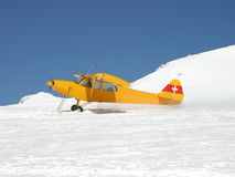 Glacier take off. A plane equipped with ski taking off from a glacier (Switzerland Stock Image
