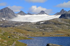 Glacier tongue. And lake at top of the mountain at jotunheimen national park in Norway stock photo