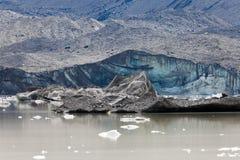 Glacier tongue calfing icebergs into glacial lake Royalty Free Stock Photo