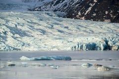 Glacier tongue between the mountains coming into glacial lake, Vatnajokull glacier, Fjallsarlon lagoon, Iceland Royalty Free Stock Images