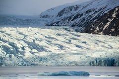 Glacier tongue between the mountains coming into glacial lake, Vatnajokull glacier, Fjallsarlon lagoon, Iceland Stock Photo