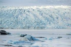 Glacier tongue between the mountains coming into glacial lake, Vatnajokull glacier, Fjallsarlon lagoon, South Iceland Stock Photography