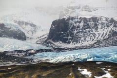 Glacier tongue between the mountains, Vatnajokull glacier, Fjallsarlon lagoon, South Iceland Royalty Free Stock Photo