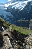 Glacier and trail nearby Grindelwald in Switzerland Stock Photos