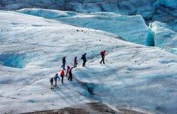 Glacier trekkers. Walk along a Vatnajokull Iceland Stock Image