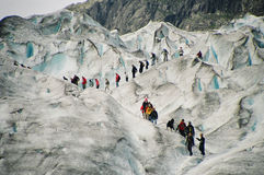 Glacier Walk, Norway. Tourists are walking on Nigardsbreen Glacier in Norway Royalty Free Stock Photos