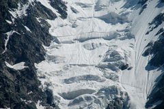 Glacier wall ice blocks falling Stock Image