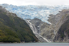 Glacier and Waterfall in Remote Mountains Stock Photos