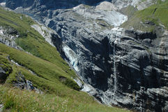 Glacier and waterfall in valley nearby Grindelwald in Alps. Stock Photography