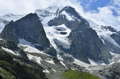 Glaciers covered large mountain. Near Georgia Stock Images