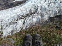 Glaciers and hiking boots. Over looking the glaciers with my hiking boots Stock Photography