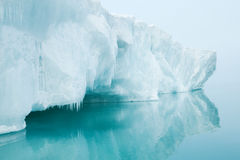 Glaciers and icebergs. Iceberg floats in the sea Stock Image