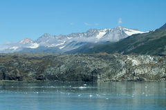 Glaciers Rocks and Clouds at Prince William Sound. Photo taken at sea looking toward glaciers and rocks along the shores of Alaska's Prince William Sound with a stock photography