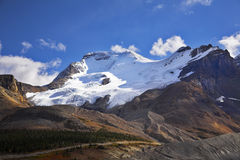 The glaciers and the snow slopes shined by the sun Royalty Free Stock Image