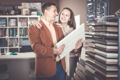 Glad adult customers choosing kitchen facade Stock Image