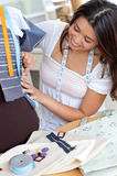 Glad asian  woman sewing Royalty Free Stock Image