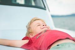 Smiling child on sea cruise Stock Photo