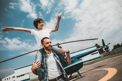 Glad boy having fun with positive father royalty free stock image