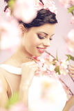 Glad brunette lady with the flowers in hair Stock Photo