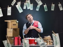 Glad businessman is laundering money Royalty Free Stock Photography